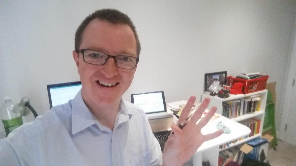 John at his desk
